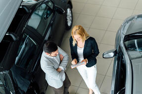 Aerial View of Car Salesperson and Customer
