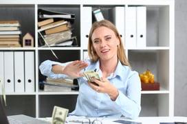 Business Woman Sprays Cash