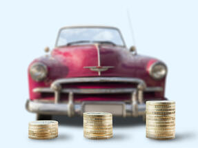 Coins Stacked in front of Vintage Car