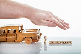 auto insurance wooden car model