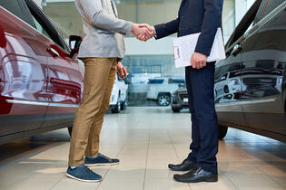 car showroom handshake