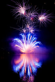 fireworks at night over water