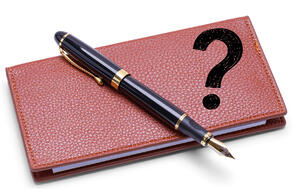 Checkbook and pen with a question mark