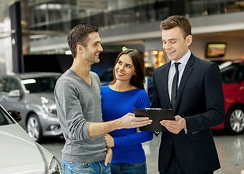 young couple buying car
