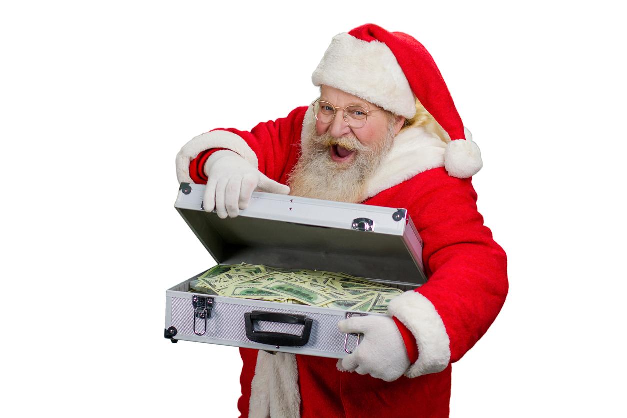 Santa with suitcase of money